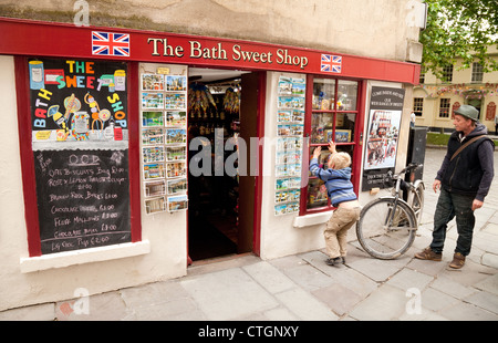 A child looking into The Bath Sweet Shop, Bath, Somerset UK - Stock Photo