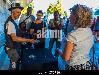 Paris, France, People Enjoying Public Events, Paris Beach, 'Paris Plages',Magician Performing in Center CIty River - Stock Photo