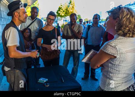 Paris, France, People Enjoying Public Events, Paris Beach, Paris Plage, Magician in Center CIty - Stock Photo