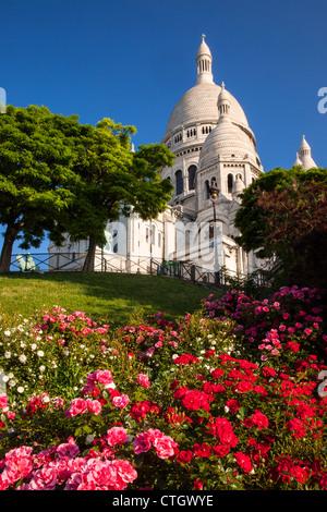 Flowers in a garden below Basilique du Sacre Coeur, Montmartre, Paris France - Stock Photo