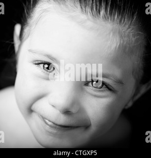 Beautiful close up portrait of little girl in black and white - Stock Photo