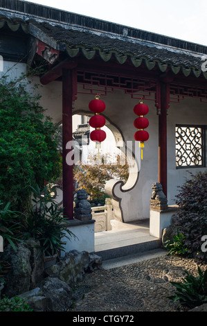 The gate of Chinese style garden with red lanterns, Suzhou of China - Stock Photo