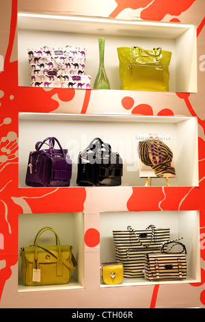 Luxury designer handbags on display in a Singapore shopping mall. - Stock Photo