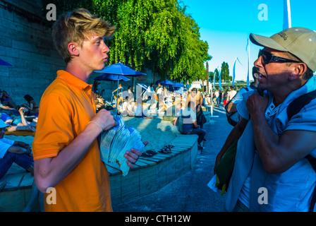 Paris, France, Young Man Tour Guide Helping Tourists at Paris Beach, 'Paris Plage', in Center CIty - Stock Photo