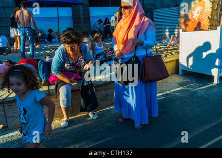 Paris, France, People Enjoying Public Events, Paris Beach, Paris Plages, in Center CIty, Arab Woman in Traditional - Stock Photo