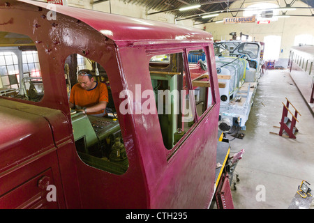 Railway Repair Shop of the 1604 Classics club.  Man working in the drivers cabin of a Diesel Locomotive 804. - Stock Photo