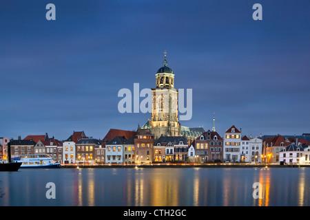 The Netherlands, Deventer, Skyline. Ijssel river. Dusk. High water. - Stock Photo