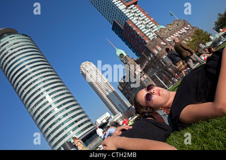 People relaxing on former quay of cruise ship company Holland America Line. now continues as Hotel New York. - Stock Photo