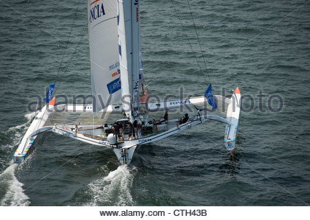 NEW YORK, USA, JULY 7TH 2012: Foncia (MOD70) skippered by Michel Desjoyeaux from France, at the start of the Krys - Stock Photo