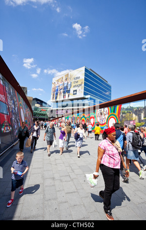 Westfield Stratford City Shopping Centre and footbridge, displaying colourful Olympic Games advertisement, London, - Stock Photo