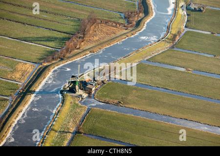 The Netherlands, Kamerik, Windmill in polder. Aerial. Winter. Frost. - Stock Photo