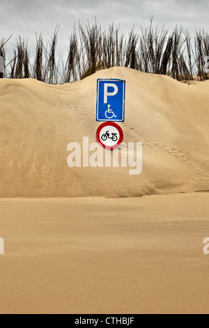 The Netherlands, Kamperland, Parking place at beach covered with sand. sign - Stock Photo