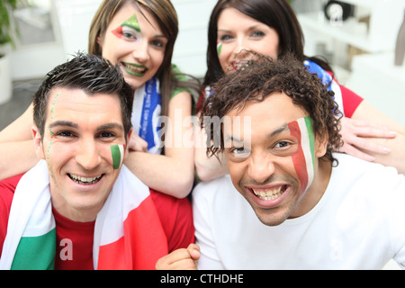 Four Italian soccer supporters - Stock Photo