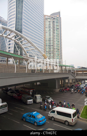BTS Skytrain station and modern office buildings in Bangkok, Thailand. - Stock Photo