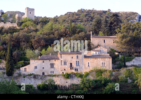 Early Morning Light on Village Houses and Castle at Oppède-le-Vieux in the Luberon Regional Park Vaucluse Provence - Stock Photo