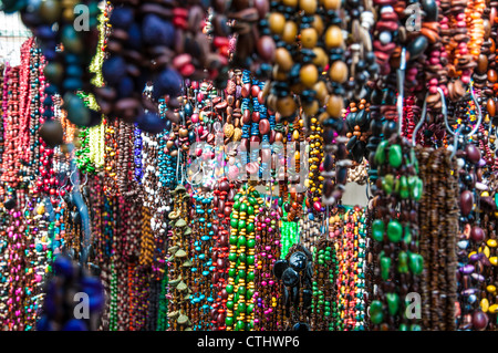 Colorful necklaces and jewelry at a market stall - Stock Photo