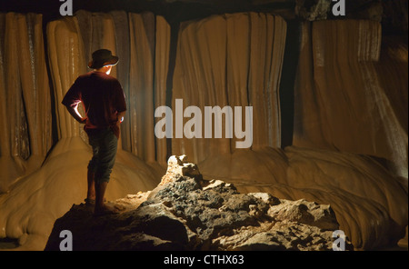 A Filipino Tour Guide Holds A Lantern Inside Sumaging Cave Or Big Cave; Sagada, Luzon, Philippines - Stock Photo