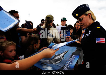 Maj. Caroline Jensen, Thunderbird 3, Right Wing pilot, interacts with admiring fans during the Joint Base Lewis - Stock Photo