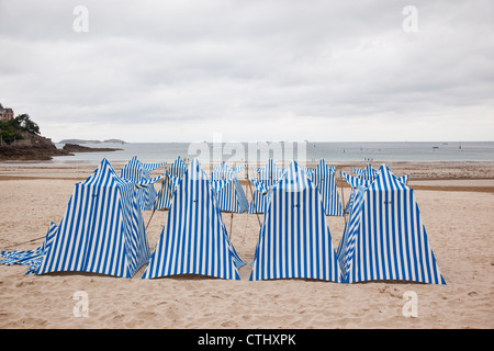 Striped beach huts on Dinard beach, Brittany, France - Stock Photo