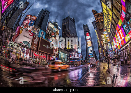 Times Square at twilight on a rainy day in New York  - Stock Photo