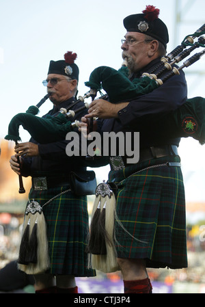 Firemen bagpipers play bagpipes - Stock Photo