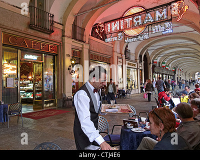 People in front of Cafe Torino , Piazza Castello , Piemont, Italy - Stock Photo