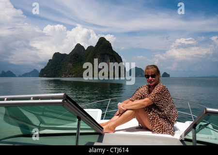 Woman sat on a boat in Phang Nga Bay, Thailand - Stock Photo