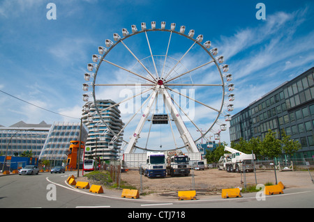 Ferris wheel in HafenCity area under development central Hamburg Germany Europe - Stock Photo