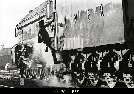 A driver climbs aboard London North Eastern Railway (LNER) Gresley class A4 steam locomotive Number 4498 named after - Stock Photo