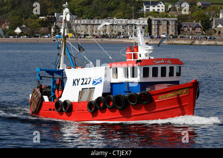 Small fishing boat Guide Me sailing off Largs in the Firth of Clyde, North Ayrshire, Scotland, UK Stock Photo