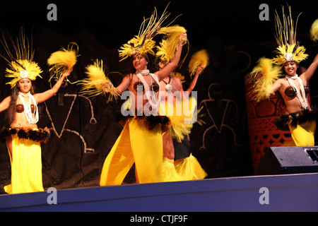 Polynesian dancers at Hawaiian Luau - Stock Photo