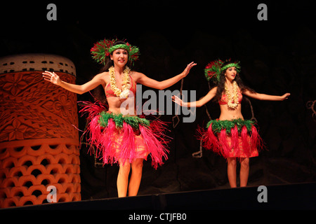 Hula dancers at Hawaiian Luau - Stock Photo