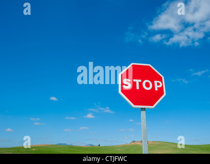 Stop sign over blue sky background - Stock Photo