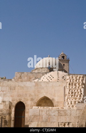 Young man sitting on the domed roof of a building inside the Citadel, Aleppo, Syria. UNESCO World Heritage Site - Stock Photo
