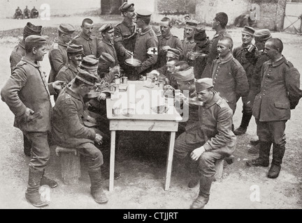 Set up official British propaganda photograph with caption, 'The way German Prisoners of War are treated after being - Stock Photo