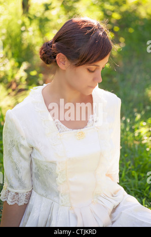 Portrait of a young, pretty woman in a victorian dress