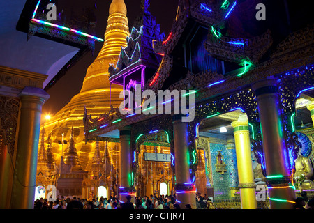 Brightly illuminated by colorful neon lights at night Shwedagon Pagoda, Yangon (Rangoon), Myanmar (Burma) - Stock Photo