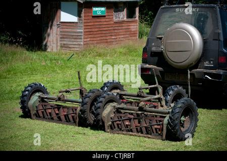 Gang mowers,clubhouse,  field, football, forest, garden, golf, grass, green, grounds, home, house, hut, - Stock Photo