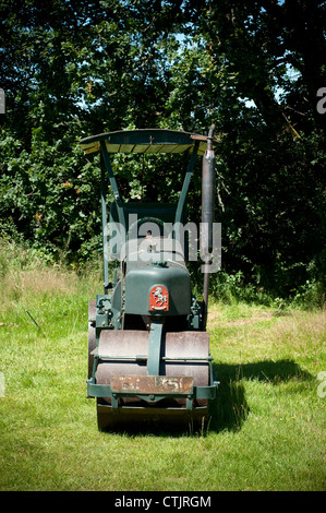 Invicta Aveling-Barford road roller ,village cricket,clubhouse, cottage, country, course, cricket, field, - Stock Photo