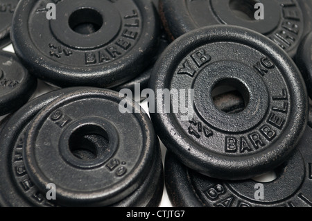 Pile of dumbbell weight discs - Stock Photo
