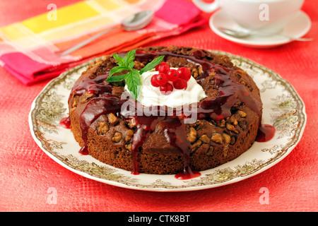 Chocolate tart with walnuts. Recipe available. - Stock Photo