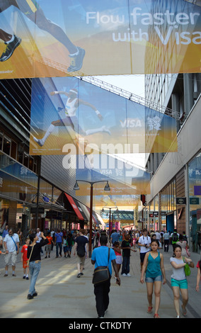 The Street at Westfield Shopping Centre, Stratford – with Olympic sponsor, VISA, banners – the entrance to the Olympic - Stock Photo