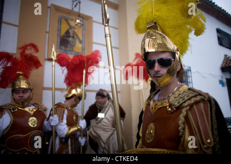 Men dressed as a Roman legionaries wait for a procession to start during an Easter Holy Week procession in Puente - Stock Photo