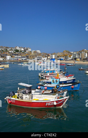 Summer sunshine on boats in the old harbour, St Ives, Cornwall, Southwest England, UK, GB, Europe - Stock Photo