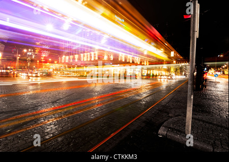 Light trails of cars passing on a busy crossing in Helsinki, Finland - Stock Photo