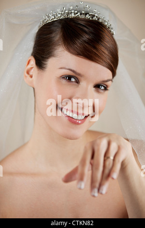 A young bride looking at her wedding ring - Stock Photo
