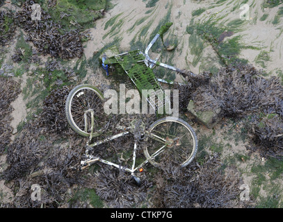 Abandoned bicycle and shopping trolley within Portsmouth harbour England - Stock Photo