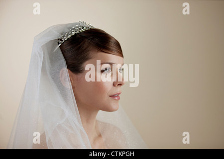 A young bride with a tear running down her face - Stock Photo