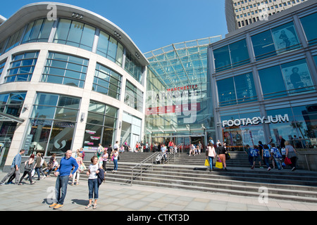 Manchester Arndale Centre busy with shoppers on a clear and sunny summer's day. - Stock Photo