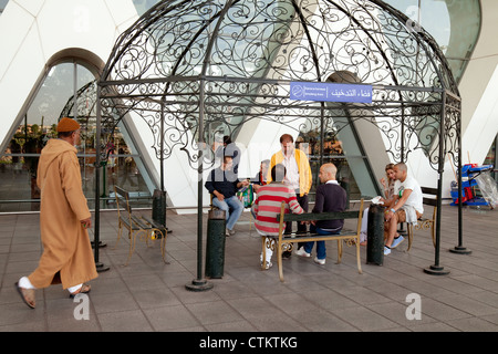 People in the smoking permitted area of the terminal, Marrakech airport, morocco Africa - Stock Photo